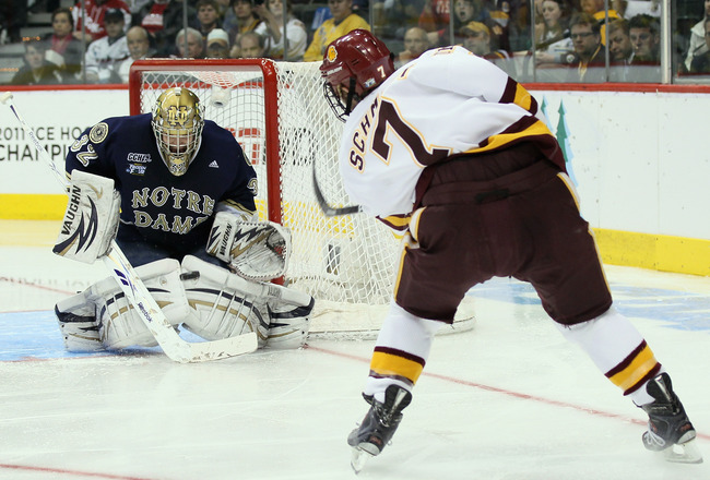 ST. PAUL, MN - APRIL 07:  Mike Johnson #32 of the Notre Dame Fighting Irish stops a shot by Kyle Schmidt #7 of the Minnesota Duluth Bulldogs during semifinals of the 2011 NCAA Men's Frozen Four on April 7, 2011 at the Xcel Energy Center in St. Paul, Minne