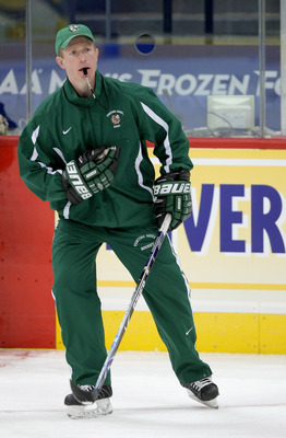 DENVER - APRIL 09:  Head coach Dave Hakstol of the University of North Dakota Fighting Sioux directs practice during the 2008 Men's Frozen Four Championship at the Pepsi Center on April 9, 2008 in Denver, Colorado.  (Photo by Doug Pensinger/Getty Images)