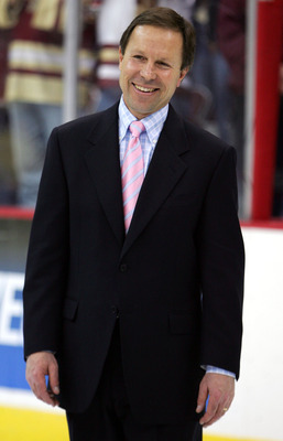 COLUMBUS, OH - APRIL 9:  Head coach George Gwozdecky of the Denver Pioneers smiles as his team accepts their awards after their victory over the North Dakota Fighting Sioux in the NCAA Frozen Four Championship game on April 9, 2005 at Value City Arena in