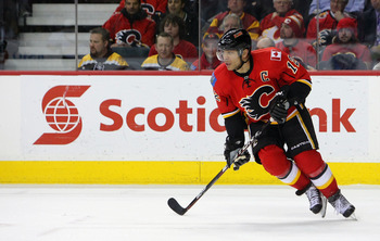 CALGARY,CANADA - FEBRUARY 22:  Jarome Iginla #12 of the Calgary Flames skates against the Boston Bruins during their NHL game at Scotiabank Saddledome, February 22,2011 in Calgary, Alberta, Canada.(Photo By Dave Sandford/Getty Images)