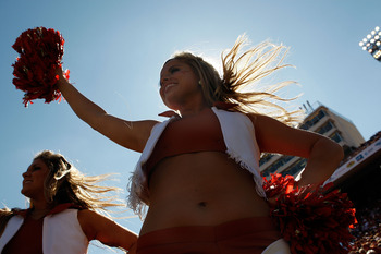 DALLAS - OCTOBER 17:  A Texas Longhorns cheerleader performs during a game against the Oklahoma Sooners at Cotton Bowl on October 17, 2009 in Dallas, Texas.  (Photo by Ronald Martinez/Getty Images)