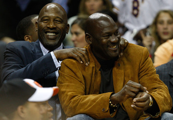 CHARLOTTE, NC - MARCH 31:  Former Laker great James Worthy (L) talks with former Bulls great and Charlotte Bobcats part owner Michael Jordan (R) on the bench during the game between Los Angeles Lakers and Charlotte Bobcats game at Time Warner Cable Arena