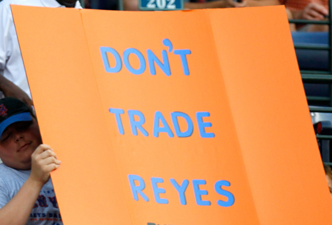 ATLANTA, GA - JUNE 14:  A young New York Mets fan holds up a sign with the words 'Don't Trade Reyes' during the game against the Atlanta Braves at Turner Field on June 14, 2011 in Atlanta, Georgia.  (Photo by Kevin C. Cox/Getty Images)
