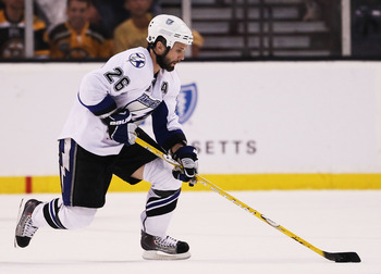 BOSTON, MA - MAY 27:  Martin St. Louis #26 of the Tampa Bay Lightning controls the puck against the Boston Bruins in Game Seven of the Eastern Conference Finals during the 2011 NHL Stanley Cup Playoffs at TD Garden on May 27, 2011 in Boston, Massachusetts