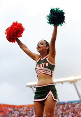 MIAMI - OCTOBER 04:  A Miami cheerleader performs after a touchdown as the Florida State Seminoles take on the Miami Hurricanes at Dolphin Stadium on October 4, 2008 in Miami, Florida. Florida State defeated Miami 41-39.  (Photo by Doug Benc/Getty Images)