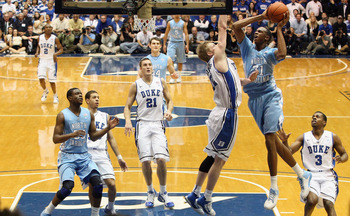 DURHAM, NC - FEBRUARY 09:  John Henson #31 of the North Carolina Tar Heels drives to the basket against Kyle Singler #12 of the Duke Blue Devils during their game at Cameron Indoor Stadium on February 9, 2011 in Durham, North Carolina.  (Photo by Streeter