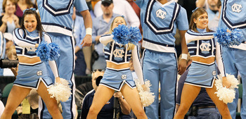 GREENSBORO, NC - DECEMBER 18:  Cheerleaders of the North Carolina Tar Heels perform against the Texas Longhorns at Greensboro Coliseum on December 18, 2010 in Greensboro, North Carolina.  (Photo by Kevin C. Cox/Getty Images)