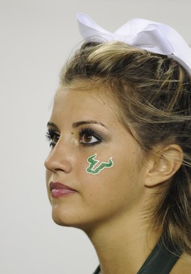 TAMPA, FL - SEPTEMBER 12: A cheerleader of the University of South Florida Bulls watches play during play against the Kansas University Jayhawks at Raymond James Stadium on September 12, 2008 in Tampa, Florida.  (Photo by Al Messerschmidt/Getty Images)