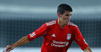 GUANGZHOU, CHINA - JULY 13:  Conor Coady of Liverpool controls the ball during the pre-season friendly match between Guangdong Sunray Cave and Liverpool at Guangdong Provincial People's Stadium on July 13, 2011 in Guangzhou, China.  (Photo by Feng Li/Gett