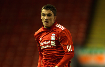 LIVERPOOL, ENGLAND - FEBRUARY 14: Adam Morgan of Liverpool in action during the FA Youth Cup match between Liverpool and Southend United at Anfield on February 14, 2011 in Liverpool, England.  (Photo by Clive Brunskill/Getty Images)