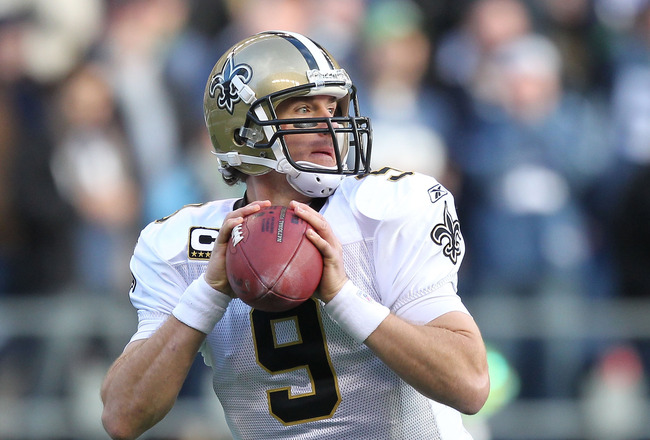 SEATTLE, WA - JANUARY 08:  Quarterback Drew Brees #9 of the New Orleans Saints scrambles against the Seattle Seahawks during the 2011 NFC wild-card playoff game at Qwest Field on January 8, 2011 in Seattle, Washington.  (Photo by Otto Greule Jr/Getty Imag