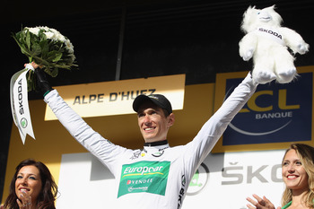 Rolland takes the stage win and white jersey in Alp'd'Huez