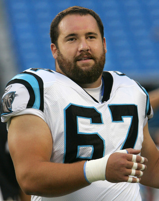 CHARLOTTE, NC - AUGUST 21:  Center Ryan Kalil #67 of the Carolina Panthers stretches before the start their preseason game against the New York Jets at Bank of America Stadium on August 21, 2010 in Charlotte, North Carolina. (Photo by Mary Ann Chastain/Ge