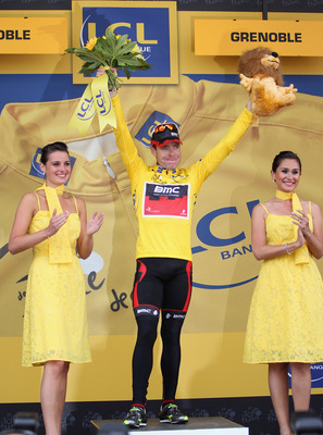 GRENOBLE, FRANCE - JULY 23:  Cadel Evans of Australia and BMC Racing Team celebrates on the podium after becoming the race leaders yellow jersey after the Individual Time Trial Stage 20 of the 2011 Tour de France on July 23, 2011 in Grenoble, France.  (Ph