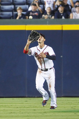 ATLANTA, GA - JULY 16: Jordan Schafer #1 of the Atlanta Braves catches a fly ball in center field in the game against the Washington Nationals on July 16, 2011 at Turner Field in Atlanta, Georgia. The Nationals beat the Braves 5-2. (Photo by Daniel Shirey