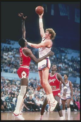 1984:  Center Bill Walton of the Los Angeles Clippers shoots the ball over center Caldwell Jones of the Chicago Bulls at the Los Angeles Sport Arena in Los Angeles, California. Mandatory Credit: Rick Stewart  /Allsport