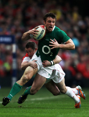 CARDIFF, WALES - MARCH 12:  Tommy Bowe of Ireland is tackled by Shane Williams of Wales during the RBS Six Nations Championship match between Wales and Ireland at the Millennium Stadium on March 12, 2011 in Cardiff, Wales.  (Photo by David Rogers/Getty Im