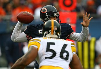 CHICAGO - SEPTEMBER 20: Jay Cutler #6 of the Chicago Bears passes the ball under pressure from LaMarr Woodley #56 of the Pittsburgh Steelers at Soldier Field on September 20, 2009 in Chicago, Illinois. The Bears defeated the Steelers 17-14. (Photo by Jona