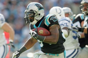 CHARLOTTE, NC - OCTOBER 28: DeAngelo Williams #34 of the Carolina Panthers carries the ball during the game against the Indianapolis Colts at Bank of America Stadium on October 28, 2007 in Charlotte, North Carolina. (Photo by Streeter Lecka/Getty Images)