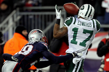 FOXBORO, MA - JANUARY 16:  Braylon Edwards #17 of the New York Jets catches a pass over Darius Butler #28 of the New England Patriots in the second quarter during their 2011 AFC divisional playoff game at Gillette Stadium on January 16, 2011 in Foxboro, M