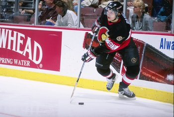 7 Mar 1997: Center Alexandre Daigle of the Ottawa Senators moves the puck during a game against the Anaheim Mighty Ducks at Arrowhead Pond in Anaheim, California. The Ducks won the game, 4-1.