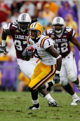 BATON ROUGE, LA - SEPTEMBER 22:  Brandon LaFell #1 of the Louisiana State University Tigers runs past Kenrick Ellis #97 and Mike Newton #42 of the South Carolina Gamecocks at Tiger Stadium September 22, 2007 in Baton Rouge, Louisiana.    (Photo by Chris G