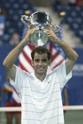 FLUSHING, NY - SEPTEMBER 8:  Pete Sampras holds the trophy above his head after winning the US Open over Andre Agassi for his 14th career Grand Slam victory and $900,000 in first place prize money on September 8, 2002 at the USTA National Tennis Center in