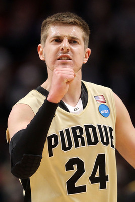 CHICAGO, IL - MARCH 20:  Ryne Smith #24 of the Purdue Boilermakers celebrates in the first half of the game against the Virginia Commonwealth Rams during the third round of the 2011 NCAA men's basketball tournament at the United Center on March 20, 2011 i