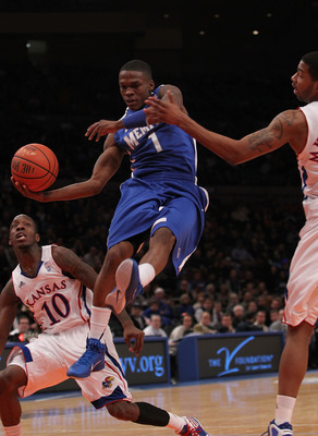 NEW YORK, NY - DECEMBER 07:  Joe Jackson #1 of the Memphis Tigers passes the ball in the lane against the Kansas Jayhawks during their game at the Jimmy V Classic at Madison Square Garden on December 7, 2010 in New York City.  (Photo by Nick Laham/Getty I