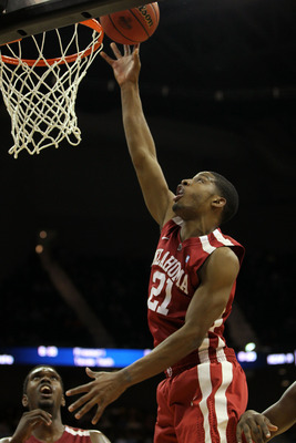 KANSAS CITY, MO - MARCH 09:  Cameron Clark #21 of the Oklahoma Sooners shoots the ball against the Baylor Bears during their game in the first round of the 2011 Phillips 66 Big 12 Men's Basketball Tournament at Sprint Center on March 9, 2011 in Kansas Cit