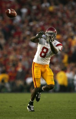 PASADENA, CA - JANUARY 01:  Dwayne Jarrett #8 of the USC Trojans catches a pass over the defense of the Michigan Wolverines on January 1, 2007 at the Rose Bowl in Pasadena, California.  (Photo by Stephen Dunn/Getty Images)