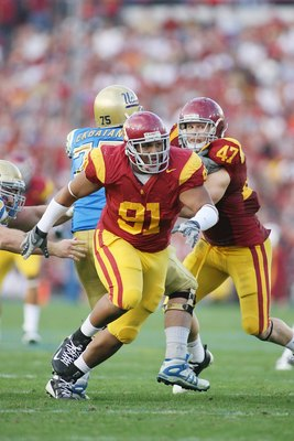 PASADENA, CA - DECEMBER 6:  Jurrell Casey #91 of the USC Trojans rushes against the UCLA Bruins on December 6, 2008 at the Rose Bowl in Pasadena, California.  USC won 28-7.  (Photo by Jeff Golden/Getty Images)