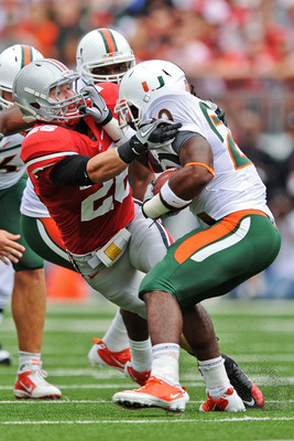 COLUMBUS, OH - SEPTEMBER 11:  Tyler Moeller #26 of the Ohio State Buckeyes hauls down a Miami Hurricanes ballcarrier at Ohio Stadium on September 11, 2010 in Columbus, Ohio.  (Photo by Jamie Sabau/Getty Images)