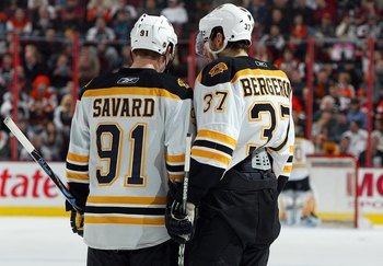 PHILADELPHIA - FEBRUARY 04:  Marc Savard #91 and Patrice Bergeron #37 of the Boston Bruins talk during a timeout against the Philadelphia Flyers on February 4, 2009 at Wachovia Center in Philadelphia, Pennsylvania.The Bruins defeated the Flyers 3-1.  (Pho