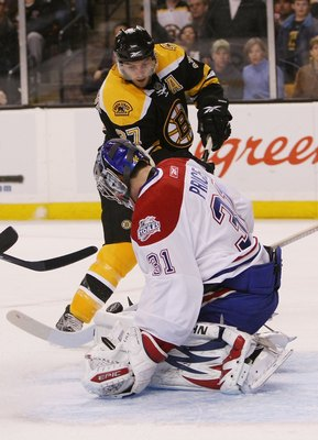 BOSTON - APRIL 16:  Patrice Bergeron #37 of the Boston Bruins tries to get a shot past Carey Price #31 of the Montreal Canadiens during Game 1 of the Eastern Conference quarterfinals of the 2009 Stanley Cup playoffs on April 16, 2009 at the TD Banknorth G
