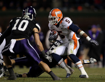 CHICAGO - NOVEMBER 20: Mikel Leshoure #5 of the Illinois Fighting Illini runs as Brian Peters #10 of the Northwestern Wildcats closes in during a game played at Wrigley Field on November 20, 2010 in Chicago, Illinois. Illinois defeated Northwestern 48-27.