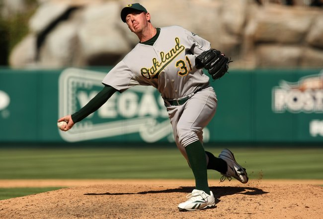 ANAHEIM, CA - SEPTEMBER 27:  Pitcher Brad Ziegler #31 of the Oakland Athletics throws a pitch against the Los Angeles Angels of Anaheim on September 27, 2009 at Angel Stadium in Anaheim, California.   The Angels won 7-4.  (Photo by Stephen Dunn/Getty Imag