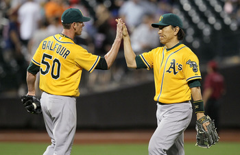 NEW YORK, NY - JUNE 21:  Hideki Matsui #55 and Grant Balfour #50 of the Oakland Athletics celebrate after defeating the New York Mets at Citi Field on June 21, 2011 in the Flushing neighborhood of the Queens borough of New York City. The A's defeated the