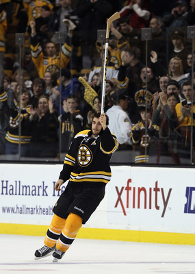 BOSTON, MA - JANUARY 11:  Patrice Bergeron #37 of the Boston Bruins salues the cheering fans after the game against the Ottawa Senators on January 11, 2011 at the TD Garden in Boston, Massachusetts. Bergeron scored his first career hat trick. The Bruins d