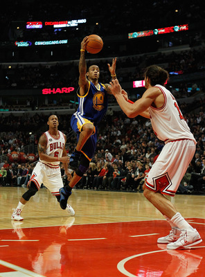 CHICAGO - NOVEMBER 11: Monta Ellis #8 of the Golden State Warriors puts up a shot between Keith Bogans #6 and Joakim Noah #13 of the Chicago Bulls at the United Center on November 11, 2010 in Chicago, Illinois. NOTE TO USER: User expressly acknowledges an