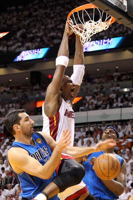 MIAMI, FL - MAY 31:  Chris Bosh #1 of the Miami Heat dunks the ball between Peja Stojakovic #16 and Brendan Haywood #33 of the Dallas Mavericks in the first half in Game One of the 2011 NBA Finals at American Airlines Arena on May 31, 2011 in Miami, Flori