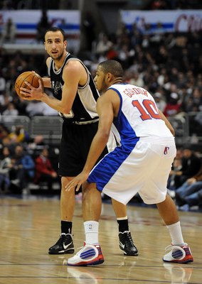 LOS ANGELES, CA - DECEMBER 13:  Manu Ginobli #20 of the San Antonio Spurs waits to pass in front of Eric Gordon #10 of the Los Angeles Clippers at Staples Center on December 13, 2009 in Los Angeles, California.  NOTE TO USER: User expressly acknowledges a