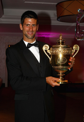LONDON, ENGLAND - JULY 03:  Novak Djokovic of Serbia holds the mens trophy at the Wimbledon Championships 2011 Winners Ball at the InterContinental Park Lane Hotel on July 3, 2011 in London, England.  (Photo by Clive Brunskill/Getty Images)