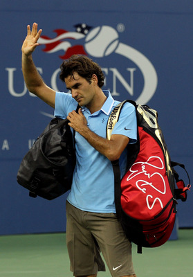 NEW YORK - SEPTEMBER 11:  Roger Federer of Switzerland waves to fans as he leaves the court after losing to Novak Djokovic of Serbia during the men's singles semifinal match on day thirteen of the 2010 U.S. Open at the USTA Billie Jean King National Tenni