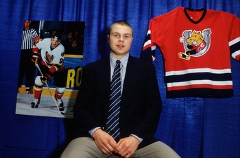 6 Jun 1996:  Top NHL draft prospect Alexander Volchkov poses with his jersey and a photograph. Mandatory Credit: Glenn Cratty/Allsport