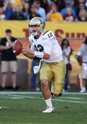 TEMPE, AZ - NOVEMBER 26:  Quarterback Richard Brehaut #12 of the UCLA Bruins scrambles with the ball during the college football game against the Arizona State Sun Devils at Sun Devil Stadium on November 26, 2010 in Tempe, Arizona. The Sun Devils defeated