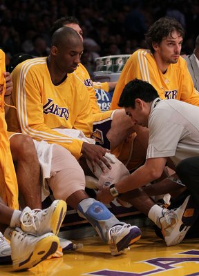 LOS ANGELES, CA - APRIL 27:  Kobe Bryant #24 of the Los Angeles Lakers has ice applied to his knees in the fourth quarter while taking on the Oklahoma City Thunder during Game Five of the Western Conference Quarterfinals of the 2010 NBA Playoffs at Staple