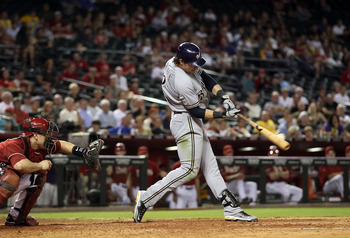PHOENIX, AZ - JULY 20:  Ryan Braun #8 of the Milwaukee Brewers bats against the Arizona Diamondbacks during the Major League Baseball game at Chase Field on July 20, 2011 in Phoenix, Arizona. The Brewers defeated the Diamondbacks 5-2 in 10 innings.  (Phot