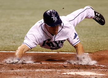 ST. PETERSBURG - APRIL 23:  Outfielder Gabe Kapler #19 of the Tampa Bay Rays scores a run against the Toronto Blue Jays during the game at Tropicana Field on April 23, 2010 in St. Petersburg, Florida.  (Photo by J. Meric/Getty Images)
