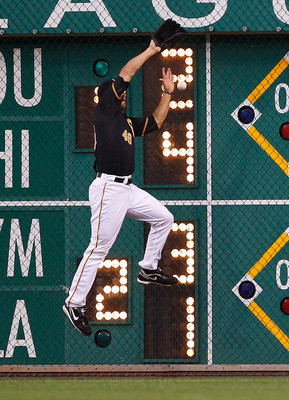 PITTSBURGH - JULY 22:  Garrett Jones #46 of the Pittsburgh Pirates misplays a ball hit into the right field fence against the St Louis Cardinals during the game on July 22, 2011 at PNC Park in Pittsburgh, Pennsylvania.  (Photo by Jared Wickerham/Getty Ima